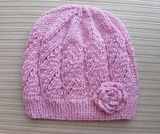 Pink_hat_in_eyelet_panels_and_knit_rose_for_a_lady_2_thumb